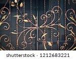 wrought iron gates  ornamental... | Shutterstock . vector #1212683221