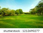 green grass field  in urban... | Shutterstock . vector #1212690277