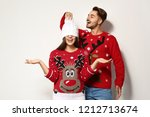 young couple in christmas... | Shutterstock . vector #1212713674