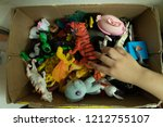 children playing with toys in a ... | Shutterstock . vector #1212755107