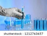 scientist holding test tube... | Shutterstock . vector #1212763657