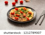 omelet with tomatoes and herbs. ... | Shutterstock . vector #1212789007