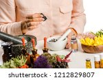 cropped image of woman adding... | Shutterstock . vector #1212829807