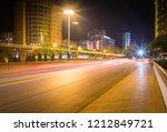 light trails on city street ... | Shutterstock . vector #1212849721