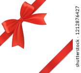 realistic red bow with ribbon ... | Shutterstock .eps vector #1212876427