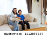 mother and son watching movie... | Shutterstock . vector #1212898834