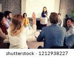 female raises hand on business... | Shutterstock . vector #1212938227