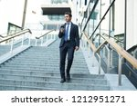 businessman with smartphone... | Shutterstock . vector #1212951271