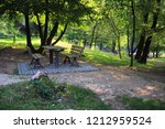 wooden table with benches for... | Shutterstock . vector #1212959524