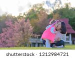 mother and daughter kiss in the ... | Shutterstock . vector #1212984721