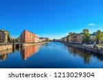 city river reflection in autumn ...   Shutterstock . vector #1213029304