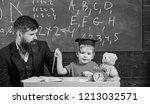 kid happy studies individually...   Shutterstock . vector #1213032571