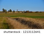 hilly heather land at a sunny... | Shutterstock . vector #1213112641