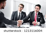 handshake business partners at... | Shutterstock . vector #1213116004