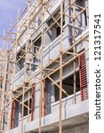 Wooden scaffolding for construction site - stock photo