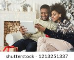 young couple sitting in... | Shutterstock . vector #1213251337
