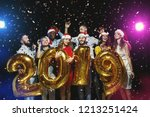 multiracial friends holding... | Shutterstock . vector #1213251424