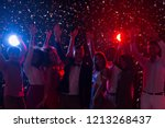 friends celebrating new year at ... | Shutterstock . vector #1213268437