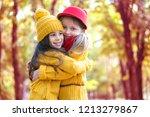 two little girls in autumn park | Shutterstock . vector #1213279867