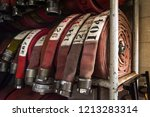 the red fire pumps by the real... | Shutterstock . vector #1213283314