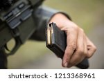 loading ammunition into a clip. ... | Shutterstock . vector #1213368961