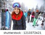 female snowboarder on ski... | Shutterstock . vector #1213372621