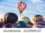 a rising hot air balloon while... | Shutterstock . vector #1213409137