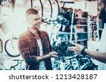 man look for helmet for bike... | Shutterstock . vector #1213428187