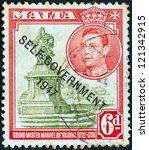 Small photo of MALTA - CIRCA 1948: A stamp printed in Malta shows statue of Manoel de Vilhena and King George VI (Self-government 1947 overprint), circa 1948.
