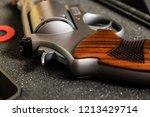 Small photo of Classic revolver .44 magnum gun close up, Violence concept