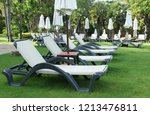 white sun loungers and white... | Shutterstock . vector #1213476811