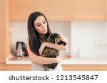 woman holding her cat pet... | Shutterstock . vector #1213545847