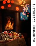 gift bag under the fireplace | Shutterstock . vector #1213551841