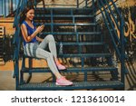 young woman resting after a... | Shutterstock . vector #1213610014