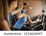 young woman and man warming up... | Shutterstock . vector #1213610047