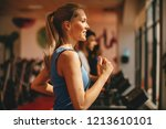 young woman warming up on... | Shutterstock . vector #1213610101