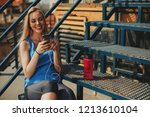young woman resting after a... | Shutterstock . vector #1213610104