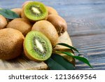 ripe fruits of kiwi whole and... | Shutterstock . vector #1213669564