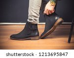 man wearing classic male boots ... | Shutterstock . vector #1213695847