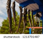 dried fish hanging on a rope... | Shutterstock . vector #1213701487