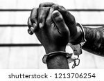 Stock photo handcuff on man s arms praying for forgiveness in church 1213706254