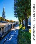 city river embankment in autumn ...   Shutterstock . vector #1213719361