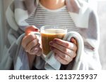 woman's hands holding hot... | Shutterstock . vector #1213725937