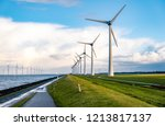 offshore windmill park with... | Shutterstock . vector #1213817137