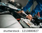 male technician works with car... | Shutterstock . vector #1213880827