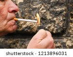 adult man lighting up the... | Shutterstock . vector #1213896031