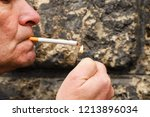 adult man lighting up the... | Shutterstock . vector #1213896034