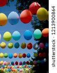 colored balloons hanging on a... | Shutterstock . vector #1213900864