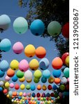 colored balloons hanging on a... | Shutterstock . vector #1213900867