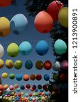 colored balloons hanging on a... | Shutterstock . vector #1213900891